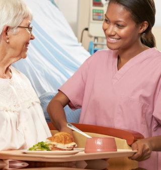 nurse and elderly woman talking